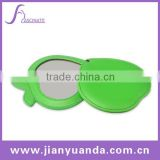 Apple shaped leather makeup mirror with sliding cover