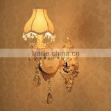 Gold fish wall light with beaded crystal hanging