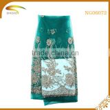 custom new arrival green metallic beaded stretch polyester sequined lace fabric for wedding dress garment