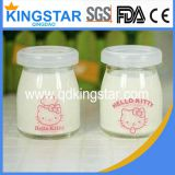clear glass milk bottle