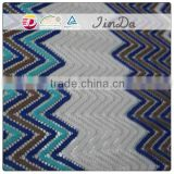 Warp knitting polyester dyed yarn lace fabric