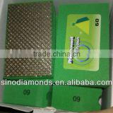 Electroplated diamond hand pads for abrasive