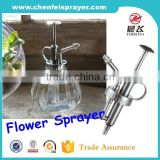2016 factory price good design colorful bottle with flower garden sprayer water pump sprayer output 1.5cc in China