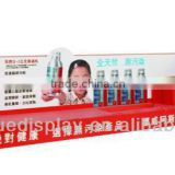 Creative eye catching fish oil front counter display stands