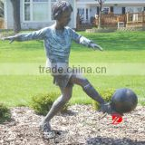 cast bronze boy playing football statues