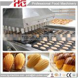 Automatic machine to make cream filled cake