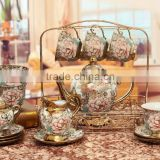 Hot sell electric golden porcelain tea Set teapot sugar bowl creamer cups and saucers Metal holder 15 Pcs 17pcs tea set