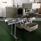Fully automatic shrink wrap machine for books
