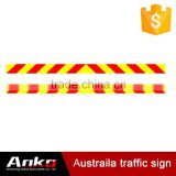 red and yellow reflective warning tape, reflective traffic sticks, slow moving vehicle marker