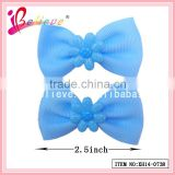 Handmade boutique grosgrain bow with plastic flower hair clips