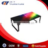 Modern coffee table with black legs & tempered glass table top in neon print