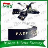 china wholesale black and gold ribbon with raised foil logo printed in packaging