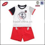 multicolor children clothing set with white printed t shirt and blank red shorts