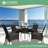 Cheap customized black or white rattan dinning round table and 4 chairs set