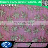 Fushia african elegant leaves embroidered tulle lace fabric for wedding dress                                                                                                         Supplier's Choice