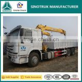 336hp 10 wheels Sinotruk tipper truck with crane 5 ton HOWO 6x4 dump truck mounted loading crane