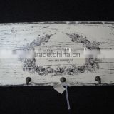 Shabby and chic white wooden wall tie hanger with metal hooks