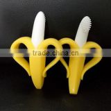 European Standard yellow-white banana shape silicone baby toothbrush for baby chewing                                                                                                         Supplier's Choice