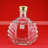 Hot sale palm-leaf fan shape whiskey bottles custom henessylne bottles 700ml white rum transparent bottles