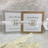 shiny gold glitter paper with fancy brooch elegant fascinating wedding invitations card