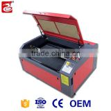 machinery with rotary worktable laser engraving machine co2 laser cutter with best price