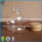 clear round shaped glass bath salt bottle with sealing wood screw cap