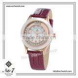 Fashionable ladies jeweled watch with alloy case rose gold iron plated and ceramic rim and purple genuine leather strap