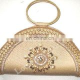 EVENING CLUTCH BAG WITH A RING