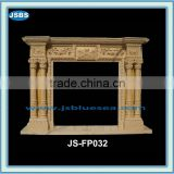 Stone carving of yellow marble fireplace mantel