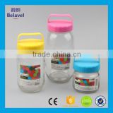 Wholesale glass storage jar food grade glass candy jar handle lid                                                                                                         Supplier's Choice