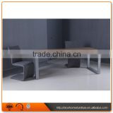 Long narrow stainless steel feet with wooden dining table