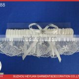 2014 New Design Lace Wedding Garter for Bridal with a white satin band and a narrow white ribbon