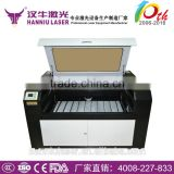 Guangzhou Hanniu 1300*900mm UD-1390 co2 laser wood cutting machine with up and down table