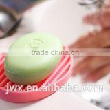 Pink silicone soap frame elliptic by the washbasin