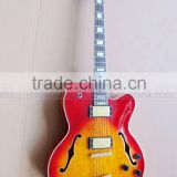 hollowbody jazz electric guitar in cherry sunburst colour
