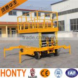 14M high quality Battery scissor lift dump truck for sale with walking aids equipment