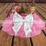 The newest design for baby girl ruffle raglan elastic pink color tutu divided skirt with big bowknot plain color adorable pants