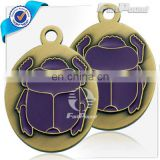 Anti gold plated purple beetle medal