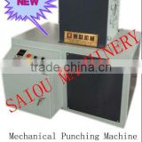 Plastic pipe perforating machine