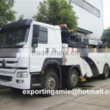 8x4 HOWO 60 ton heavy duty 360 degree rotator recovery truck for sale