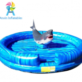 Kids and adults outdoor mechanical rodeo shark rides games with inflatable mattress for sale