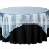 Light blue satin round table overlay for weddings