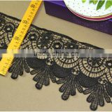 Guangzhou Factory price black flower design polyester material lace trim by roll for garment