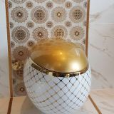 Luxury golden ceramic egg shape bathroom wall hung toilet with good quality bowl from china