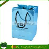 Hotsale Promotional High quality fancy paper garment packaging bag with handle design shopping bag china manufacture