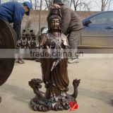 bronze kuan yin statue standing on dragon sculpture