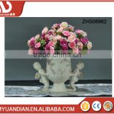 Miniature polyresin flower pot with two cute angel babies for decoration