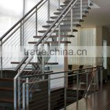 Stainless steel railings with braided aircraft cables and Milled walnut handrails                                                                                                         Supplier's Choice
