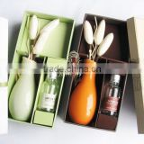 Ceramic bottle diffuser gift set with reed flower bud