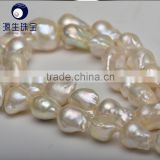 cream white 11-13mm AAA grade nucleated baroque pearls string wholesale